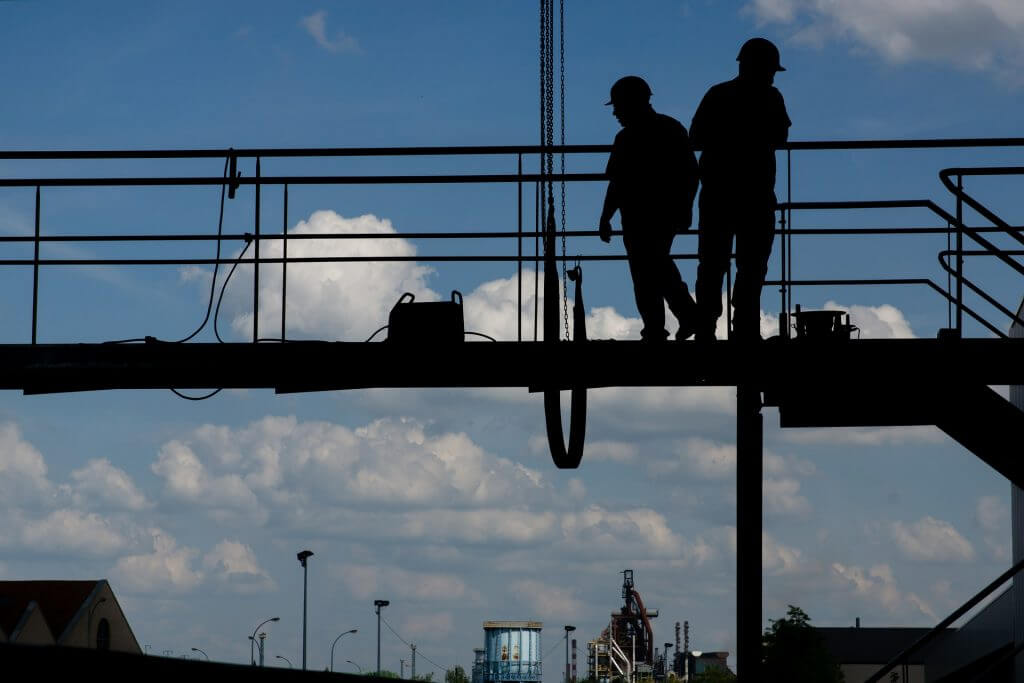 Image of construction workers on site