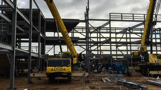 Altida operating a mobile crane on site