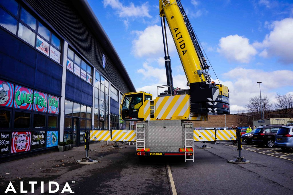 Terex Demag AC 100 Tonne 4L Mobile Crane and Altida Man Riding Cage at Chesterfield Football Club working Maintenance after Storm Doris 3