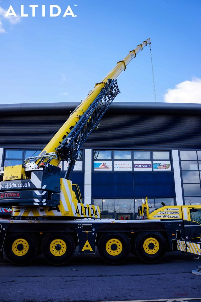 Terex Demag AC 100 Tonne 4L Mobile Crane and Altida Man Riding Cage at Chesterfield Football Club working Maintenance after Storm Doris 8